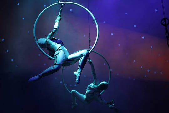 Aerialists put on a show at the circus.