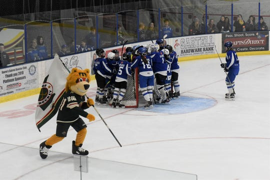 Nordy, the Minnesota Wild mascot, skates laps as the Sartell peewee team huddles before the Youth Hockey Spotlight game Monday, Feb. 3, 2020, in Bernick's Arena in Sartell.