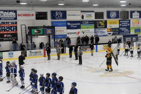 The Minnesota Wild singer John deCausmeaker sings as Sartell and Buffalo youth teams stand for the national anthem Monday, Feb. 3, 2020, in Bernick's Arena in Sartell.