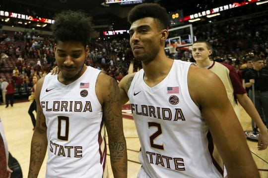 Florida State Seminoles guard Rayquan Evans (0) and Florida State Seminoles guard Anthony Polite (2) hug after a game between FSU and the University of North Carolina at Donald L. Tucker Civic Center Monday, Feb. 3, 2020.