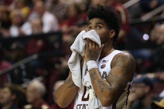 Florida State Seminoles guard Rayquan Evans (0) wipes sweat from his eyes during a game between FSU and the University of North Carolina at Donald L. Tucker Civic Center Monday, Feb. 3, 2020.