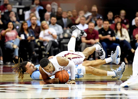 Feb 3, 2020; Tallahassee, Florida, USA; Florida State Seminoles guard MJ Walker (23) falls over North Carolina Tar Heels guard Cole Anthony (2) while fighting for a loose ball during the first half at Donald L. Tucker Center. Mandatory Credit: Melina Myers-USA TODAY Sports