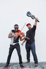Wil B., violist, and Kev Marcus, violinist, combine their classical training and hip- hop influences in Black Violin, playing Opening Nights on Feb. 13.