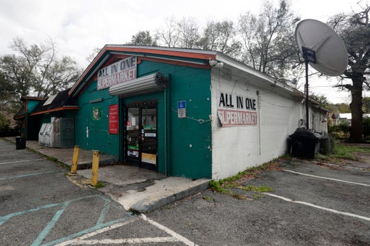 The Blueprint Intergovernmental Agency is looking at whether it will acquire an ailing old convenience store on Alabama Street to possibly bring a grocery store into the Griffin Heights neighborhood.