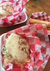 Arepas with shredded beef and crumbled cheese and chicken with guacamole and cheese as well as tequeños, with a light crust wrapped around salty white cheese are on the menu at VeneBites.