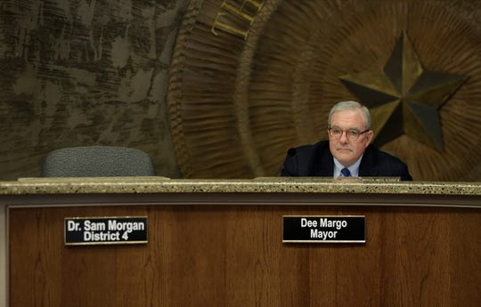Mayor Dee Margo listens to public comment on El Paso Electric on Tuesday, Feb. 4, 2020, as District 4 city Rep. Sam Morgan's seat sits empty.