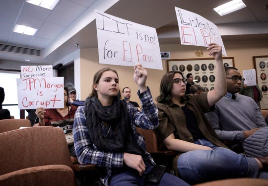 Emma Moshaver, left, and Isabella Soto protest the pending sale of El Paso Electric during the Feb. 4 City Council meeting.
