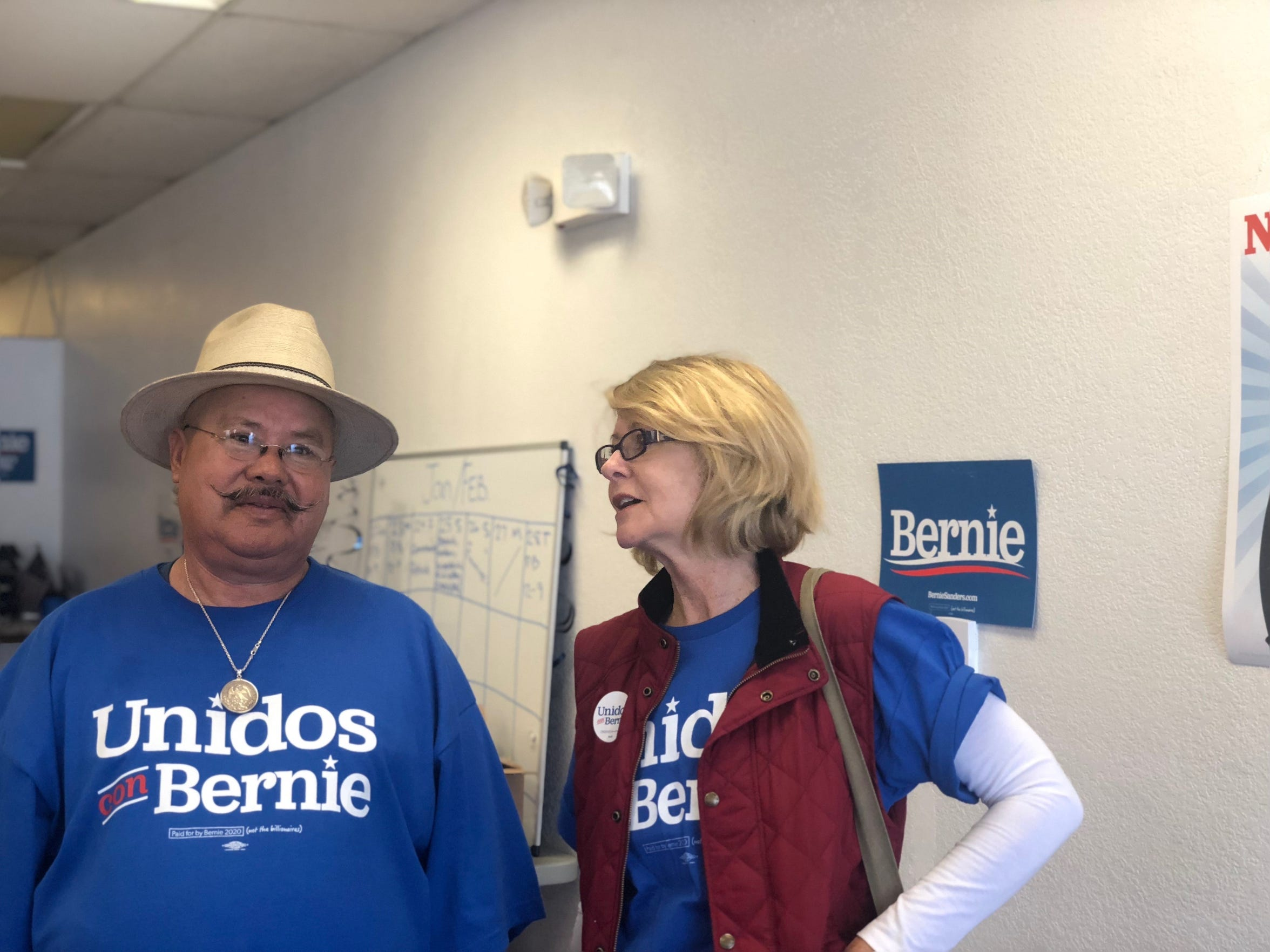 Volunteers Vicente Arenas and Catherine Vidal chat in the Bernie Sanders Oxnard campaign office before canvassing homes recently. They volunteer for the candidate almost every weekend.