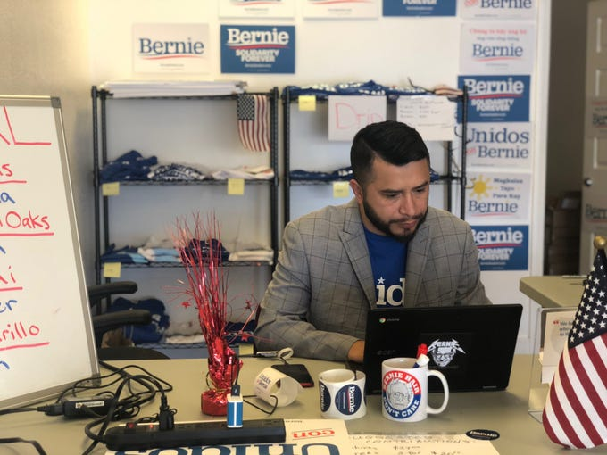 Edin Enamorado, Oxnard field organizer for the Bernie Sanders presidential campaign, works at his desk on Feb. 1. Sanders' Oxnard campaign office opened on Jan. 10, and it hosts bilingual canvasses every Saturday and Sunday.