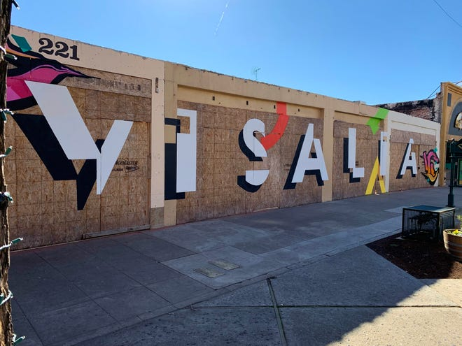A new mural is making a colorful splash in downtown Visalia one year after a tragic Christmas fire destroyed the Main Street building.