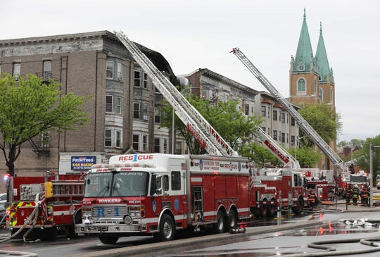 Yonkers firefighters battle a three-alarm fire at 221 Nepperhan Avenue in the city, May 12, 2018.  Mark Vergari/The Journal News