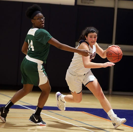 Nehemie Fleurimond (14) of Woodlands guards Briarcliff 's Cat Carrafiello (13) during girls basketball game at Briarcliff High School Feb. 3, 2020. Briarcliff defeats Woodlands 63-38.