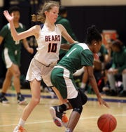 Briarcliff 's Kaitlyn Ryan (10) guards Samantha Nicholson (1) of Woodlands during girls basketball game at Briarcliff High School Feb. 3, 2020. Briarcliff defeats Woodlands 63-38.