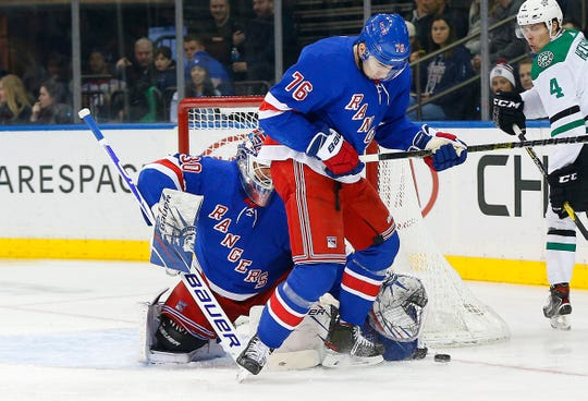 Feb 3, 2020; New York, New York, USA; New York Rangers goaltender Henrik Lundqvist (30) and New York Rangers defenseman Brady Skjei (76) combine to make a save against the Dallas Stars during the first period at Madison Square Garden. Mandatory Credit: Andy Marlin-USA TODAY Sports