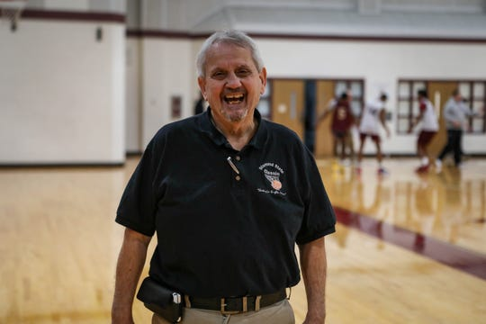 John Gretchen, founder and president of the Diamond State Classic girls basketball tournament, poses in the gym at St. Elizabeth High School.