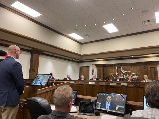 Wichita Falls Assistant City Manager Blake Jurecek talks to council Tuesday about plans for the future full-service hotel and conference center.