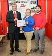 AFBF Vice President Scott Vander Wal pictured with Calumet County Farm Bureau members Gloria and Simon Regan. Calumet County Farm Bureau's 'Meet Your Local Farmer' event was recognized as a winner in the County Activities of Excellence competition.