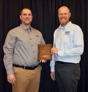 Green County Farm Bureau president Ben Huber (left) of Green County represented Wisconsin in the Excellence in Agriculture Award at the AFBF Annual Convention.