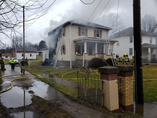 Firefighters from various departments are fighting a house fire on Maysville Pike near Rural King.