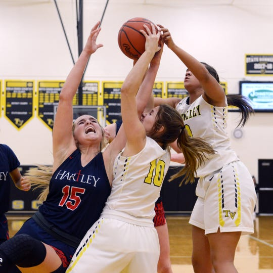 Hartley's Kami Kortokrax, left, fights for a rebound with Tri-Valley's Hannah King and Kyndal Howe during Tri-Valley's 57-33 win against visiting Columbus Hartley on Monday night in Dresden.