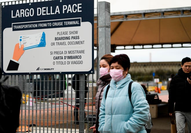 Passengers exit the cruise port in Civitavecchia, Italy,    on Jan. 31 after health officials lifted the quarantine on the Costa Smeralda. A passenger suspected of having coronavirus was instead diagnosed with the flu.
