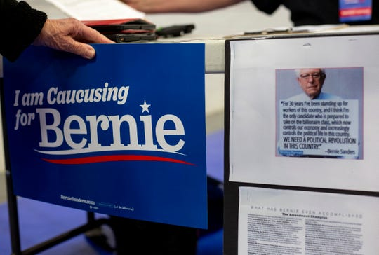 A Bernie Sanders table is set up before the Democratic presidential caucus on Monday, Feb. 3, 2020 in Larchwood, Iowa.