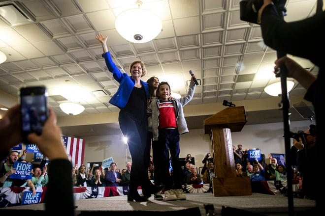 U.S. Elizabeth Warren, D-Mass., accompanied by her grandchildren take the stage to address the crowd at her caucus night party on Monday, Feb. 3, 2020, at Forte in downtown Des Moines, Iowa. At the time of her speech results of the caucuses were still unknown.