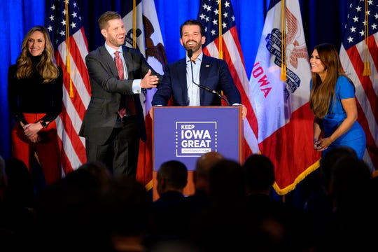 """Donald Trump Jr. (C) speaks with his brother Eric (2nd L) and wife Lara, as well as his girlfriend Kimberly Guilfoyle (R) during a """"Keep Iowa Great"""" press conference in Des Moines, IA, on February 3, 2020."""