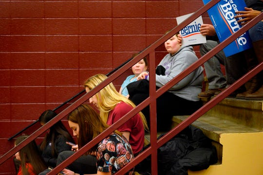 Candidate Bernie Sanders' supporters wait to be counted at at an Iowa caucus in Des Moines on Feb. 3, 2020.