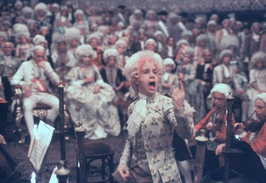 """Tom Hulce (center) stars as the enigmatic musical genius Mozart in """"Amadeus."""""""