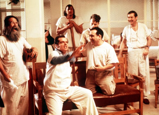 """R.P. McMurphy (Jack Nicholson, center) leads a crew of disorderly mental patients in """"One Flew Over the Cuckoo's Nest."""""""