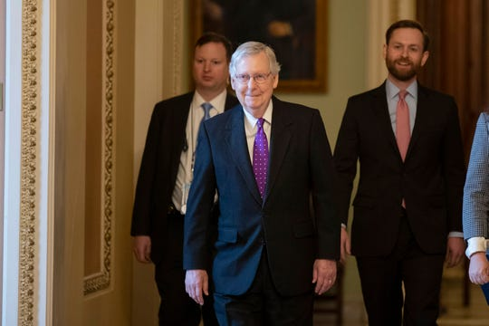 Senate Majority Leader Mitch McConnell, R-Ky., walks from the Senate Floor in the U.S. Capitol on Tuesday.