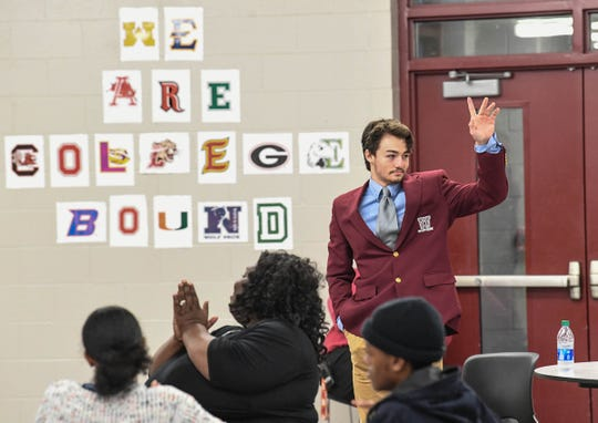 Blair Garner waves as he was honored with a preferred walk on to play football at Charleston Southern University on National Letter of Intent ceremony at Westside High School in Anderson Wednesday, February 5, 2020.