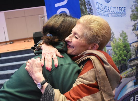 "Touched by child Holocaust survivor Jeannine Burk's (right) story, Louisiana College freshman Breanna Terral met with Burk after the LC program ""Lost Innocence: Children of the Holocaust"" to give her a hug."