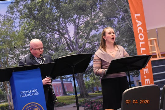 "Dr. Kate Rawls (right), assistant professor of music, and Dr. Joshua Davis, director of bands.forÊ""Lost Innocence: Children of the Holocaust,"" performed a musical tribute to victims of the Holocaust at a remembrance event presented by the LC DepartmentsÊof History and Music Tuesday"