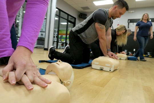 Cherie Garrison (right), Hands On CPR Training, watches as students practice their CPR skills during a session at KS Fitness in Toms River Tuesday, February 4, 2020.  Garrison owns the 20-year-old Toms River-based business and teaches CPR and other life-saving techniques to a range of clients statewide, including medical professionals, teachers, fitness instructors, corporations, and residents.