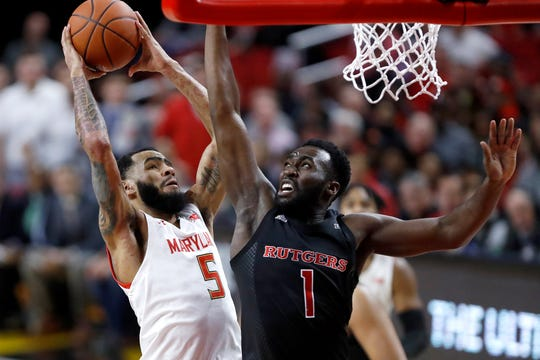 Maryland guard Eric Ayala (5) goes up for a shot against Rutgers forward Akwasi Yeboah (1)