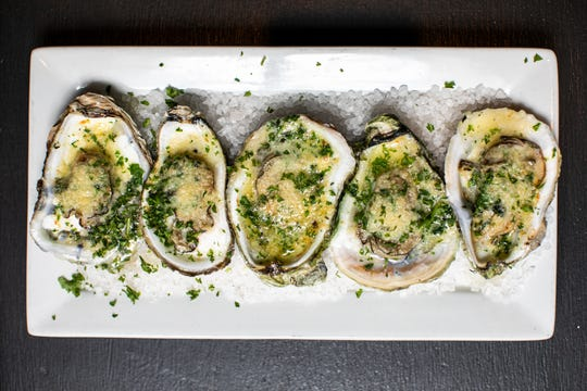 Charbroiled oysters with butter and Parmesan at Point Lobster Bar & Grill in Point Pleasant Beach.
