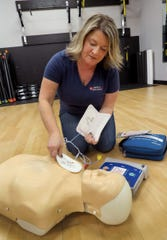 Cherie Garrison, Hands On CPR Training, demonstrates how to set up an AED during a session at KS Fitness in Toms River Tuesday, February 4, 2020.  Garrison owns the 20-year-old Toms River-based business and teaches CPR and other life-saving techniques to a range of clients statewide, including medical professionals, teachers, fitness instructors, corporations, and residents.