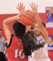Cooper's Kya Speights, right, pressures Wichita Falls High's Roselyn Hurtado in the second quarter. Cooper beat the Lady Coyotes 64-16 in the District 4-5A game Tuesday at Cougar Gym.