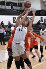 Abilene High's Destiny Potts (11) battles for an offensive rebound against San Angelo Central at Eagle Gym. The Lady Cats pulled away for a 37-26 win.