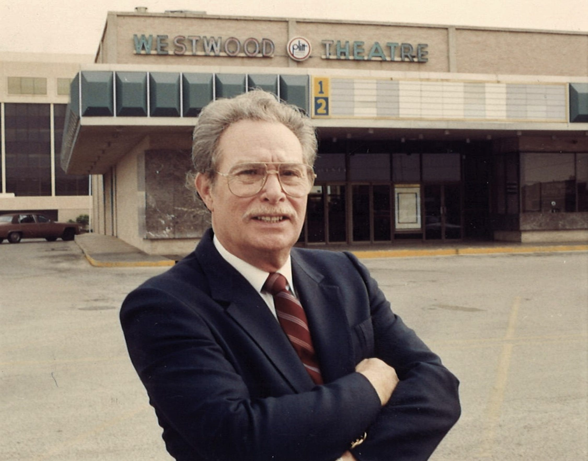 Frank Sheffield, pictured outside the Westwood Theatre in 1991, when he was to turn the former single-screen, first-run theater to a two-screen, discount movie house.
