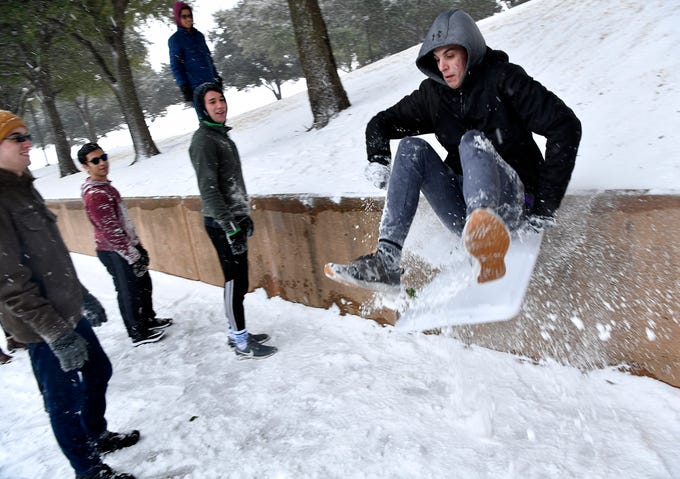 Ryan Lewis of Dripping Springs slides off a hill at Abilene Christian University during Wednesday's snowfall Feb. 5, 2020. Lewis was unhurt and went back to do it again.