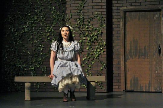 "Mary (Shelby Walker) sings near the wall of the garden in this rehearsal scene from Hardin-Simmons University's ""The Secret Garden."""