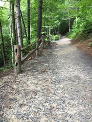 "This ""two-track,"" or gravel trail that leads to popular waterfalls in DuPont State Recreational Forest will remain open during the flood watch this week, as opposed to the narrower, dirt, remote ""single-track"" trails, which are closed."