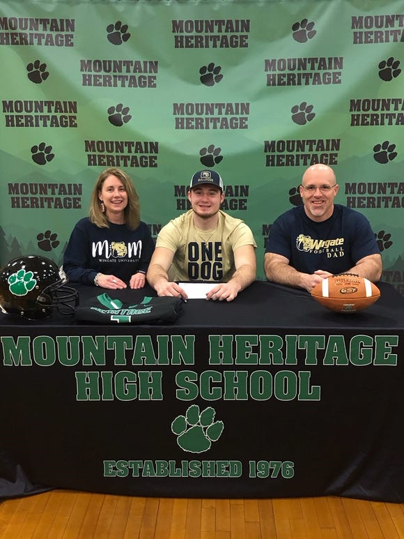 Mountain Heritage senior Cole Shehan signs to play college football at Wingate.