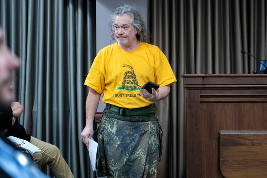 """Bernard Carmen returns to his seat after speaking during public comment of a Buncombe County Commissioners meeting at 200 College Street on Feb. 4, 2020. Gun rights activists attended the meeting in large numbers to ask for Buncombe to become a """"Second Amendment Constitutional Rights Protection County."""""""