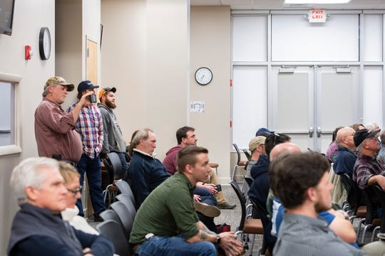 "Attendees watch the Buncombe County Commissioners meeting for a full overflow room on the first floor of 200 College Street on Feb. 4, 2020. Gun rights activists attended the meeting in large numbers to ask for Buncombe to become a ""Second Amendment Constitutional Rights Protection County."""