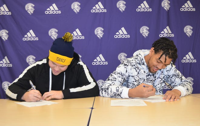 Lakeview's Zac Brower and Tayvon Hughes sign their National Letter of Intent on Signing Day Wednesday morning. Brower will play college football at Siena Heights and Hughes is going to Ferris State University.