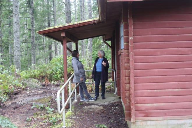 itsap County Commissioner Charlotte Garrido, right, on a tour of Camp Calvinwood with Kirsten Jewell, left, Kitsap's housing and homeless manager. The shuttered Camp Calvinwood is now being considered as a site for a tiny home village.